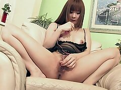 Energized Japanese plays with her trimmed cunt in a lovely solo